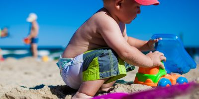 Boy playing with sand at Beach.